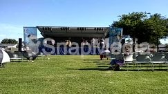 Airfield, Airport, Apparel, Automobile, Backyard, Building, Camping, Car, Chair, Clothing, Countryside, Crowd, Field, Food, Football, Forest, Furniture, Grass, Grassland, Human, Land, Lawn, Meal, Musical Instrument, Musician, Nature, Outdoor Play Area, Outdoors