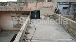 Alley, Alleyway, Apartment Building, Apparel, Automobile, Banister, Brick, Building, Car, City, Clothing, Concrete, Construction, Curtain, Flagstone, Floor, Flooring, Guard Rail, Handrail, Hardhat, Helmet, High Rise, Home Decor, Indoors, Machine, Nature, Outdoors, Path, Plywood, Prison, Road, Roof, Room, Shutter, Slate