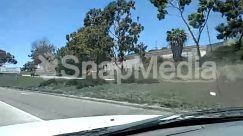 Advertisement, Asphalt, Billboard, Building, Bush, City, Freeway, Grand Theft Auto, Grass, Highway, House, Housing, Intersection, Land, Nature, Outdoors, Path, Plant, Road, Road Sign, Sign, Slope, Street, Symbol, Tarmac, Text, Town, Transportation, Tree, Urban, Vegetation, Villa
