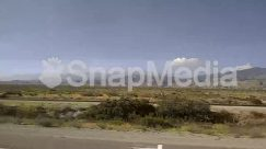Advertisement, Airfield, Airport, Asphalt, Automobile, Billboard, Building, Cable, Car, Caravan, City, Countryside, Desert, Dirt Road, Electric Transmission Tower, Field, Freeway, Grass, Grassland, Gravel, Highway, Hill, Housing, Human, Intersection, Land, Landscape, Machine, Mountain, Mountain Range, Nature, Outdoors, Panoramic, Person, Pickup Truck, Plant, Plateau, Power Lines, Road, Rv, Scenery