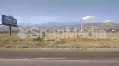 Advertisement, Airfield, Airport, Asphalt, Billboard, Building, Cable, Countryside, Engine, Field, Freeway, Grass, Ground, Guard Rail, Highway, Land, Landscape, Machine, Motor, Mountain, Nature, Outdoors, Panoramic, Path, Plant, Road, Scenery, Sign, Slope, Soil, Sport, Sports, Symbol, Tarmac, Transportation, Tree, Turbine, Urban, Utility Pole, Vegetation, Vehicle, Water, Wind Turbine