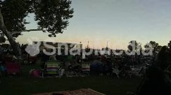 Audience, Automobile, Camping, Car, Chair, Concert, Crowd, Female, Festival, Food, Furniture, Girl, Grass, Human, Lawn, Leisure Activities, Meal, Music Band, Musical Instrument