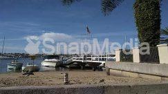 Apparel, Architecture, Asphalt, Boardwalk, Boat, Bridge, Building, Clothing, Marina, Nature, Outdoors, Overpass, Pier, Plant, Port, Road