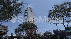 Amusement Park, Apparel, Building, City, Clothing, Crowd, Ferris Wheel, Human, Machine, Pedestrian, Person, Theme Park, Town, Transportation, Urban, Vehicle, Wheel