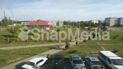 Abies, Automobile, Building, Campus, Car, Fir, Grass, House, Housing, Human, Landscape, Nature, Neighborhood, Outdoors, Parking, Parking Lot, Person, Plant, Road, Roof