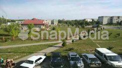 Aerial View, Asphalt, Automobile, Building, Bus, Car, Caravan, Coupe, Grass, Housing, Human, Landscape, Nature, Neighborhood, Outdoors, Parking, Parking Lot