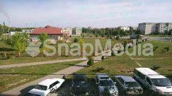 Aerial View, Asphalt, Automobile, Building, Campus, Car, Caravan, Coupe, Grass, Human, Landscape, Nature, Neighborhood, Outdoors, Parking, Parking Lot