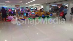 Airport, Airport Terminal, Apparel, Arcade Game Machine, Automobile, Bowling, Cafeteria, Car, Car Show, Clothing, Display, Electronics, Floor, Flooring, Footwear, Human, LCD Screen, Long Sleeve, Machine, Monitor, Pants, Person, Restaurant, Screen, Shoe, Shop, Shopping Mall, Sleeve, Terminal, Toy