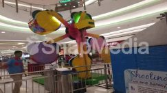 Amusement Park, Apparel, Arcade Game Machine, Banister, Clothing, Handrail, Human, Indoor Play Area, Inflatable, Person, Play Area, Playground, Railing, Shop, Shorts, Sphere, Theme Park