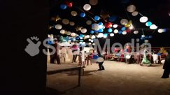 Apparel, Audience, Ball, Balloon, Circus, Clothing, Crowd, Dance Pose, Festival, Floor, Flooring, Footwear, Furniture, Home Decor, Human, LED, Lamp, Lantern, Leisure Activities, Light, Lighting, Music Band, Musical Instrument, Musician, Night Life, Performer, Person
