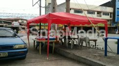 Animal, Automobile, Awning, Building, Cafe, Cafeteria, Canine, Canopy, Car, Chair, Dog, Flagstone, Food, Food Court, Furniture, Human, Kiosk