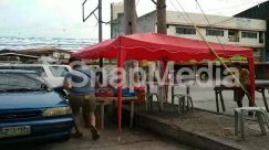 Apparel, Automobile, Awning, Back, Bazaar, Building, Bus, Cafe, Canopy, Car, Chair, City, Clothing, Dining Table, Flagstone, Food, Furniture, Human, Kiosk, Machine, Market, Metropolis, Neighborhood, Path, Pavement, Pedestrian, Person, Restaurant