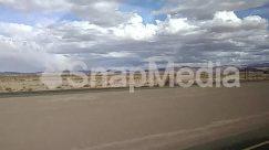 Aircraft, Azure Sky, Car, Cloud, Cumulus, Desert, Dune, Fence, Freeway, Gravel, Ground, Highway, Horizon, Land, Landscape, Nature, Panoramic, Plant, Plateau, Road, Sand, sky, Soil, Trailer Truck