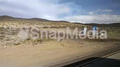 Advertisement, Apparel, Architecture, Automobile, Azure Sky, Bus, Car, Cloud, Countryside, Desert, Display, Electronics, Flag, Freeway, Gravel, Ground, Highway, Land, Landscape, Mountain, Nature, Panoramic, Path, Plant, Sand, sky, Street