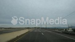Asphalt, Bridge, Building, City, Freeway, Highway, Human, Person, Road, Street, Tarmac, Town, Transportation, Urban, Utility Pole, Vehicle
