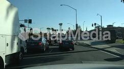 Advertisement, Automobile, Blue Sky, Boardwalk, Building, Car, City, Coupe, Electric Pole, Freeway, Highway, Human, Intersection, Label, License Plate, Light, Parking, Parking Lot, Person, Pickup Truck, Road, Road Sign, Road Signal, Sports Car, Street, Sun Light, Tree