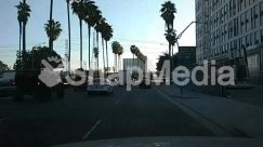 Advertisement, Arecaceae, Asphalt, Automobile, Bicycle, Boardwalk, Building, Cable, Car, City, Construction, Downtown, Freeway, Grand Theft Auto, High Rise, Highway, Human, License Plate, Light, Machine, Metropolis, Office Building, Palm Tree, Person, Plant, Riding Bicycle, Road, Street, Sun Light, Tarmac, Town, Transportation, Tree, Truck
