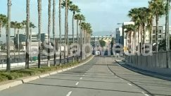 Advertisement, Alley, Alleyway, Apartment Building, Architecture, Arecaceae, Asphalt, Bridge, Building, Car, City, Convention Center, Downtown, Freeway, High Rise, Highway, Housing, Human, Light, Neighborhood, Office Building, Overpass, Palm Tree, Parking, Path, Pavement, Pedestrian, Person, Pickup Truck, Plant, Road, Road Sign, Road Signal, Running, Sidewalk, Sun Light, Tree