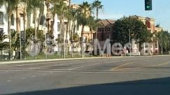 Apartment Building, Architecture, Arecaceae, Asphalt, Automobile, Building, Car, City, Downtown, Freeway, Grass, High Rise, Highway, House, Housing, Human, Intersection, License Plate, Light, Lighting, Neighborhood, Palm Tree, Path, Pedestrian, Person, Plant, Road, Road Signal, Street, Sun Light, Tarmac, Text, Tree