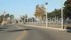 Asphalt, Blue Sky, Building, Downtown, Electric Pole, Fence, Freeway, Gravel, High Rise, Highway, Housing, Intersection, Lamp Post, Land, Nature, Neighborhood, Outdoors, Path, Plant, Road, Squirrel, Street, Suburb, Sun Light, Tarmac, Town, Tree