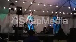 Apparel, Audience, Audio Speaker, Bass Guitar, Cottage, Crowd, Drum, Drummer, Electronics, Guitar, Guitarist, Human, Indoors, Interior Design, Karaoke, Leisure Activities, Lighting, Music Band, Musical Instrument, Musician