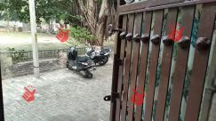 Alley, Alleyway, Arbour, Drain, Electric Pole, Gate, Grass, Gravel, Handrail, Home Decor, Human, Motor Scooter, Motorcycle, Outdoors, Path, Pedestrian, Person, Scooter, Sidewalk, Squirrel, Streer, Sun Light, Tree