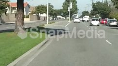 Advertisement, Asphalt, Automobile, Building, Car, City, Downtown, Furniture, Grass, Highway, Housing, Human, Indoors, Intersection, Light, Nature, Neighborhood, Outdoors, Parking, Parking Lot, Path, Pavement, Pedestrian, Person, Plant, Road, Road Sign, Road Signal, Runway, Shadow, Sun Light, Tree, Utility Pole, Wall