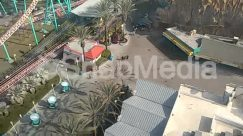 Advertisement, Aircraft, Alley, Alleyway, Amusement Park, Arecaceae, Arena, Basketball, Basketball Court, Building, Downtown, Freeway, Hotel, House, Human, Intersection, Neighborhood, Outdoors, Palm Tree, Path, Pedestrian, Person, Plant, Rail, Railway, Road, Roller Coaster, Shop, Shopping Mall, Sport, Sun Light, Theme Park, Town, Train Track, Tree, Urban