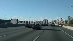 Asphalt, Automobile, Building, Car, City, Freeway, Highway, License Plate, Nature, Outdoors, Parking, Parking Lot, Road, Street, Tarmac, Town, Transportation, Truck, Urban
