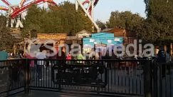 Adventure, Amusement Park, Building, Coaster, Crowd, Fence, Gate, House, Housing, Human, Leisure Activities, Nature, Outdoor Play Area, Outdoors, People, Person, Railing, Roller Coaster, Theme Park