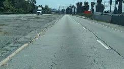 Asphalt, Building, City, Freeway, Highway, Human, Nature, Path, Pavement, Person, Road, Sidewalk, Street, Tar, Tarmac, Town, Urban