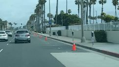 Apartment Building, Architecture, Arecaceae, Asphalt, Automobile, Barricade, Bridge, Building, Bus Stop, Car, City, Coast, Cone, Downtown, Fence, Fire Hydrant, Freeway, Guard Rail, High Rise, Highway, Human, Hydrant, Intersection, Land, Light, Nature, Neighborhood, Ocean, Outdoors, Palm Tree, Path, Pavement, Pedestrian