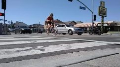 Road, Human, Person, Traffic Light, Light, Asphalt, Tarmac, Urban, Building, City, Town, Street, Intersection, Transportation, Vehicle, Social distancing
