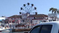 Human, Person, Amusement Park, Car, Vehicle, Automobile, Transportation, Construction Crane, Ferris Wheel, Theme Park, Water, Waterfront, Utility Pole, Port, Dock