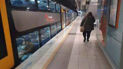 Vehicle, Transportation, Terminal, Train, Train Station, Furniture, Bench, Person, Floor, Subway, Flooring, Indoors, Clothing, Apparel, Shoe