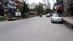 Automobile, Vehicle, Car, Transportation, Motorcycle, Person, Road, Town, Building, City, Urban, Street, Machine, Wheel, Path