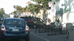 Person, Automobile, Transportation, Car, Vehicle, Sedan, Road, Bike, Bicycle, Parking, Parking Lot, Machine, Wheel, Pedestrian, Urban