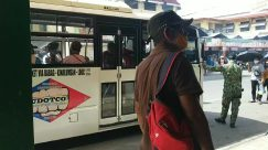 Person,Vehicle,Bus,Transportation,Truck,Apparel,Sunglasses,Automobile,People,covid-19 transportation,men in uniform,public transportation on covid-19