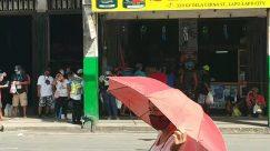 Person, Apparel, Clothing, Shorts, Vehicle, Transportation, Van, Pedestrian, Bus, Crowd, Canopy, Motorcycle, Tent, Pants, Market