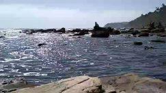 Water, Outdoors, Nature, Ocean, Sea, Rock, Shoreline, Person, Coast, Landscape, Panoramic, Scenery, Vehicle, Transportation, Building