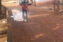 Bicycle, Vehicle, Bike, Wheel, Machine, Building, Urban, Soil, Shorts, Mountain Bike, Ground, Motorcycle, Footwear, Sport, Sports