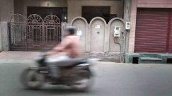 Bicycle, Vehicle, Bike, Wheel, Motorcycle, Vespa, Motor Scooter, Gate, Footwear, Shoe, Flagstone, Scooter, Pedestrian, Moped, Building