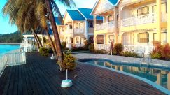 Building, Hotel, Resort, Housing, House, Villa, Mansion, Water, Neighborhood, Hot Tub, Jacuzzi, Tub, Wood, Porch, Plant