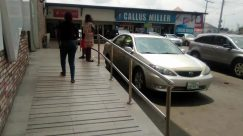 Shoe, Footwear, Car, Vehicle, Automobile, Wheel, Banister, Handrail, Windshield, Flooring, Female, Floor, Skirt, Tire, Building