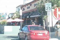 Automobile, Vehicle, Car, Awning, Canopy, Building, Kiosk, City, Town, Sedan, Road, Housing, Restaurant, Neighborhood, Cafe