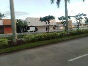 Car, Automobile, Vehicle, Grass, Plant, Building, Road, Vegetation, City, Town, Hotel, Tree, Housing, House, Villa
