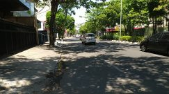 Building, City, Town, Street, Road, Automobile, Vehicle, Car, Path, Neighborhood, Motorcycle, Tree, Plant, Pavement, green