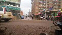 Street, Town, Road, Building, City, Wheel, Motorcycle, Vehicle, Footwear, Shoe, Pants, Truck, Downtown, Countryside, Rural