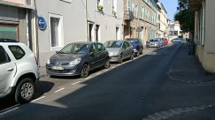 Vehicle, Automobile, Car, Street, Building, City, Town, Road, Sedan, Parking, Parking Lot, Bumper, Path, Neighborhood, Spoke